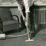 1950s man with vacuum cleaner
