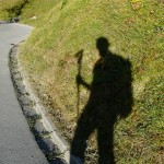 Shadow of hiker with selfie stick